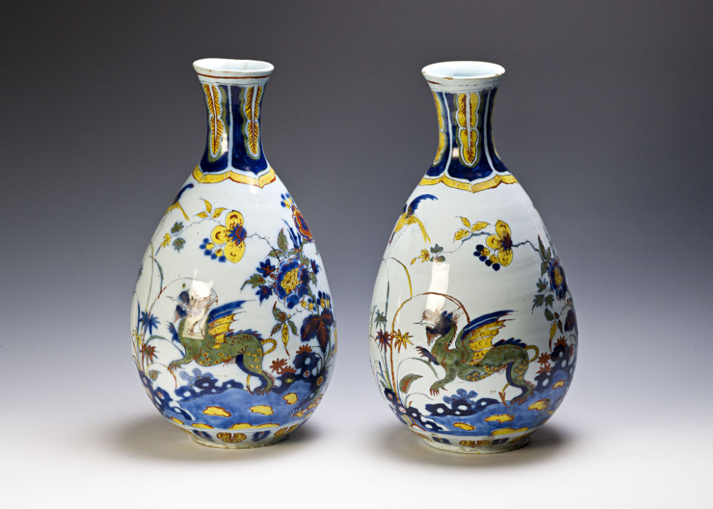 A pair of Dutch Delft polychrome bottles, circa 1700.