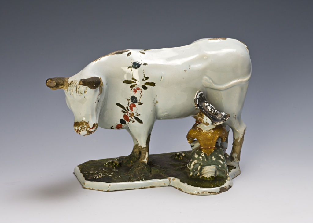 A Dutch Delft milkmaid and cow,  early 18th Century.