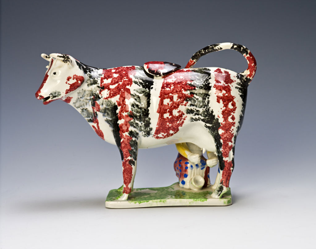 A cow creamer and cover, probably Portabello, early 19th Century.
