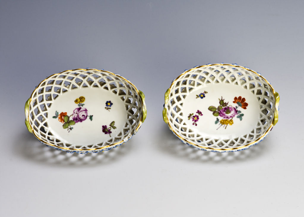 A set of four miniature two handled oval reticulated Meissen baskets, circa 1760/80.
