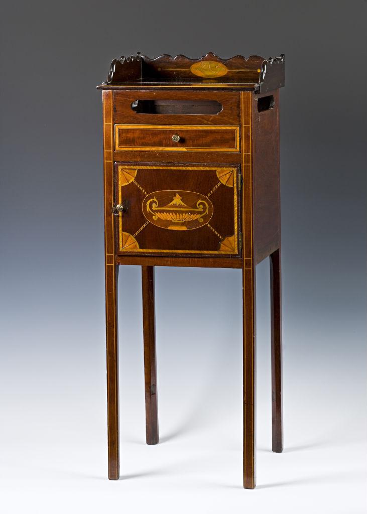 A George III mahogany pot cupboard, circa 1790.