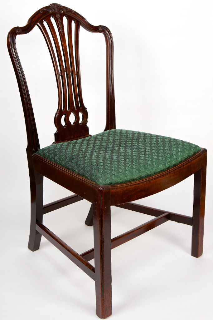 A set of four George III mahogany side chairs, circa 1780.