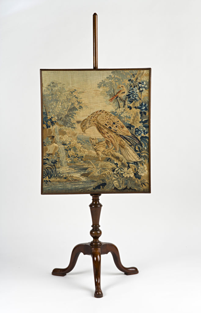 A George II mahogany pole screen, circa 1750.