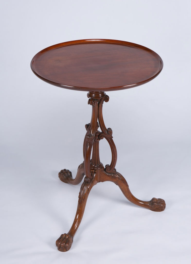 A mahogany tripod table, part 18th Century.