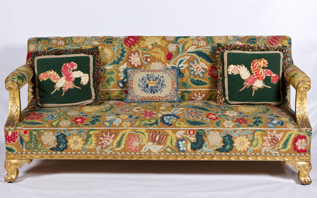 A George II style giltwood settee, circa 1840.