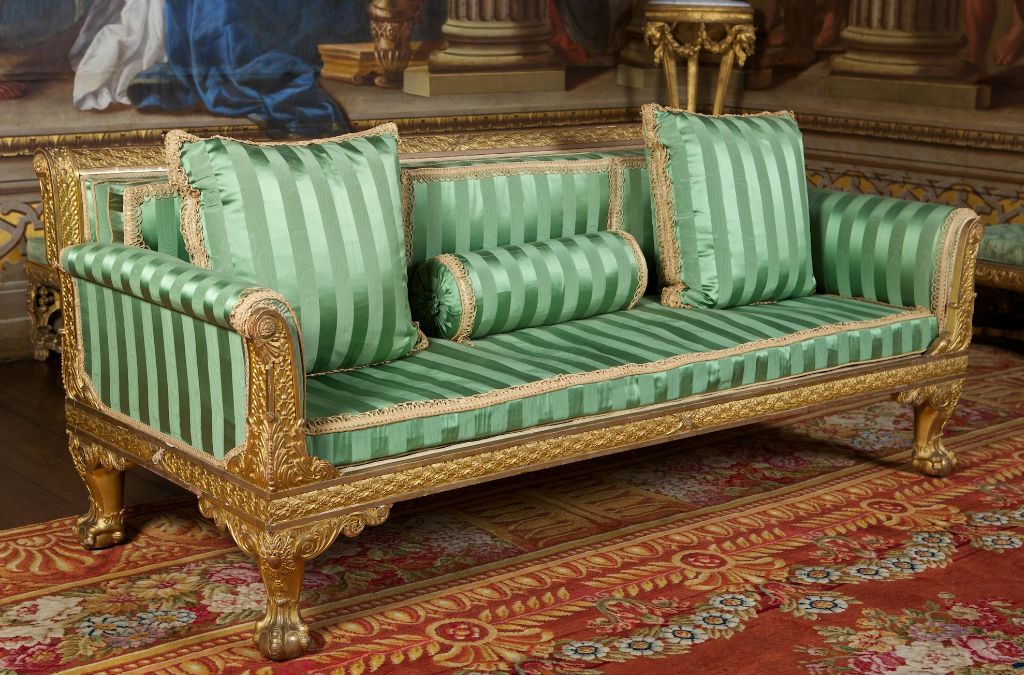 A pair of George IV carved giltwood sofas, in the manner of Marsh & Tatam, circa 1825.