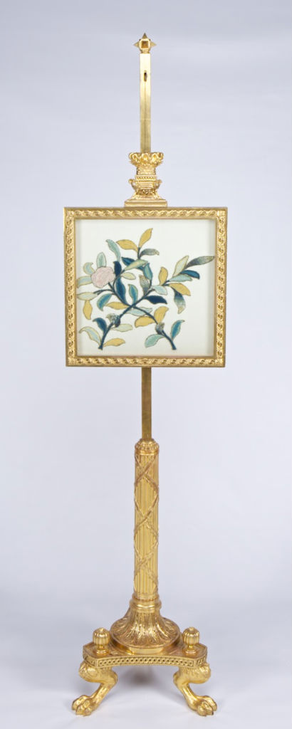 A pair of giltwood and gesso pole screens, circa 1825.