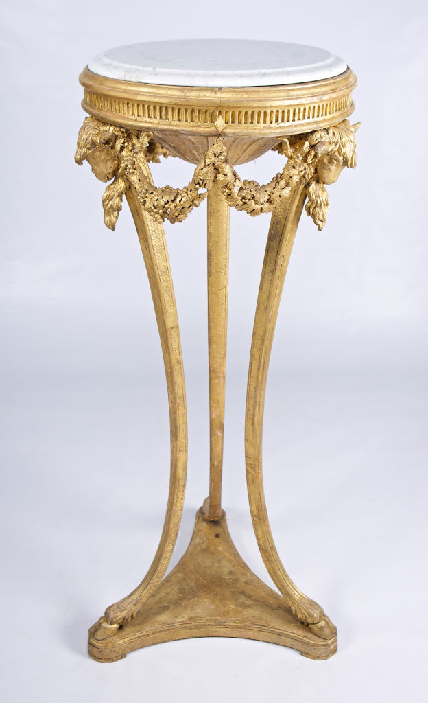 A set of four George III carved giltwood candle-stands, by Mayhew and Ince, 1767.