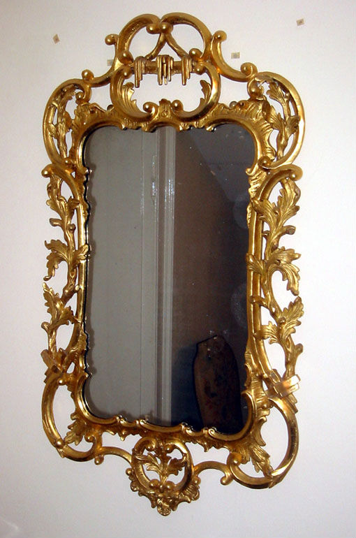 A George III carved giltwood wall mirror.