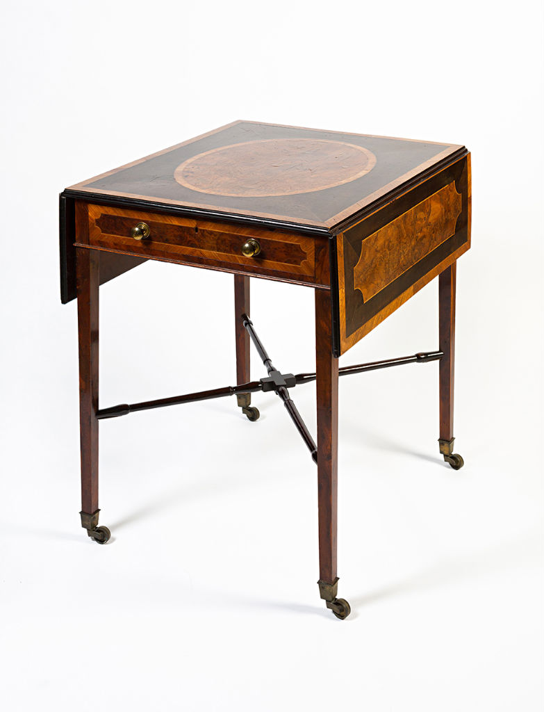 A George III harewood and burr yew Pembroke table, in the style of Mayhew and Ince, circa 1785.