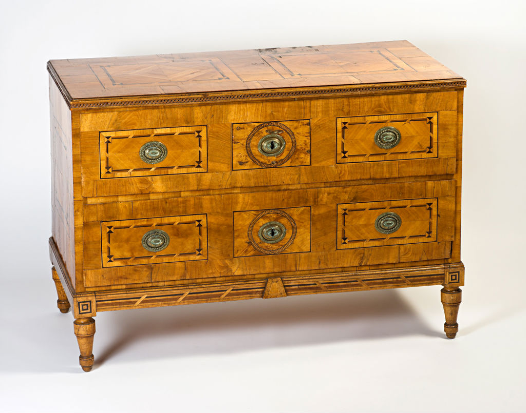 A German walnut parquetry commode, late 18th Century.