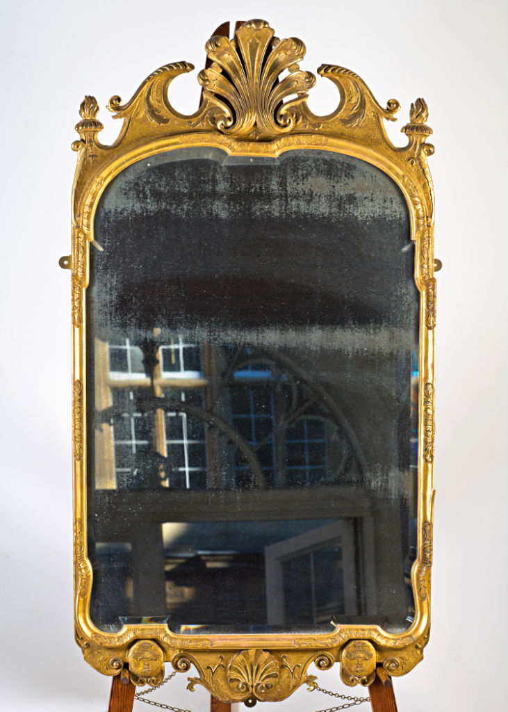 A Queen Anne giltwood mirror, circa 1714.