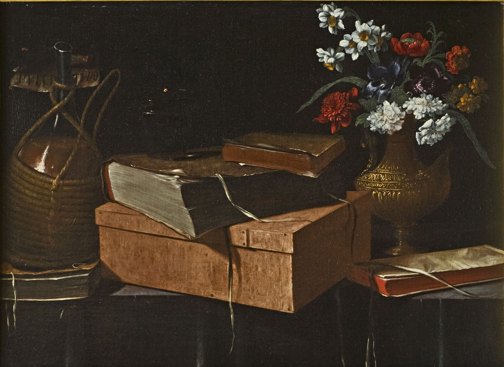 A Still Life with Flowers in a Vase, Books and a Flagon of Wine, Spanish or Neapolitan School, circa 1650.