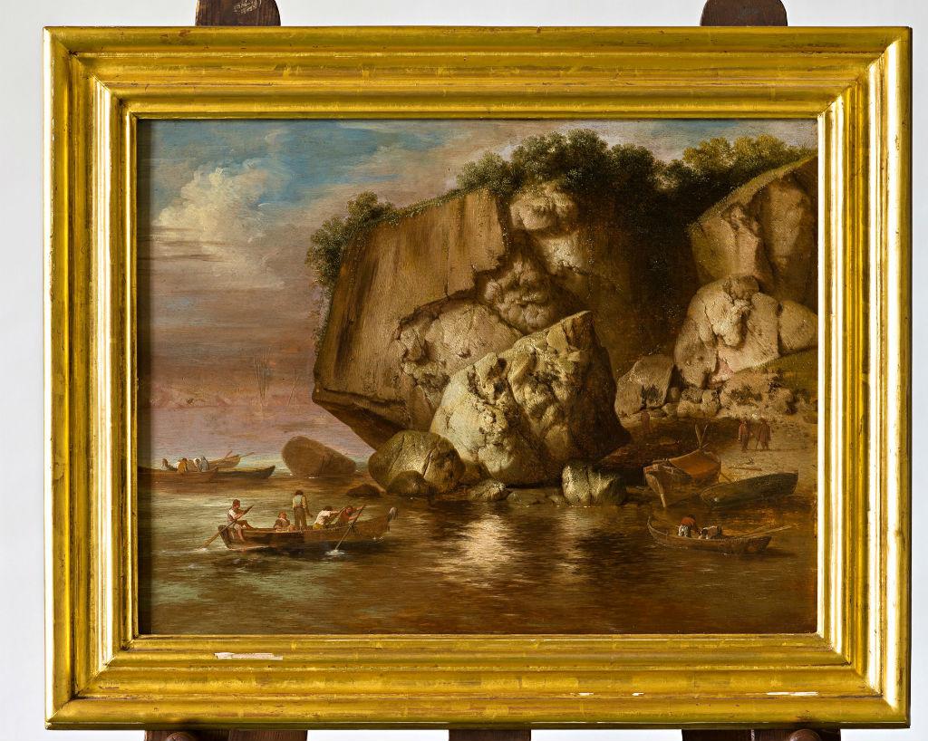 A Rocky Coastal Landscape with Figures in Boats by Jacobus Sibrandi Mancadan (1602-1680).