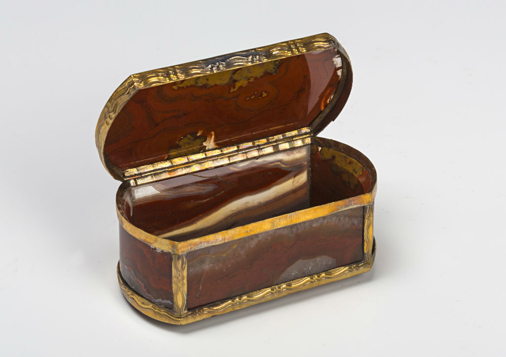 A gilt-metal-mounted hardstone snuff box, circa 1770.