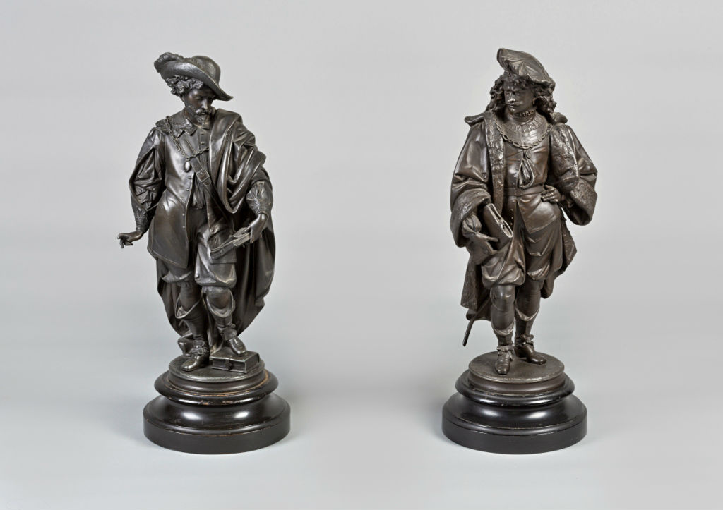 A pair of French spelter models of 17th Century poets.