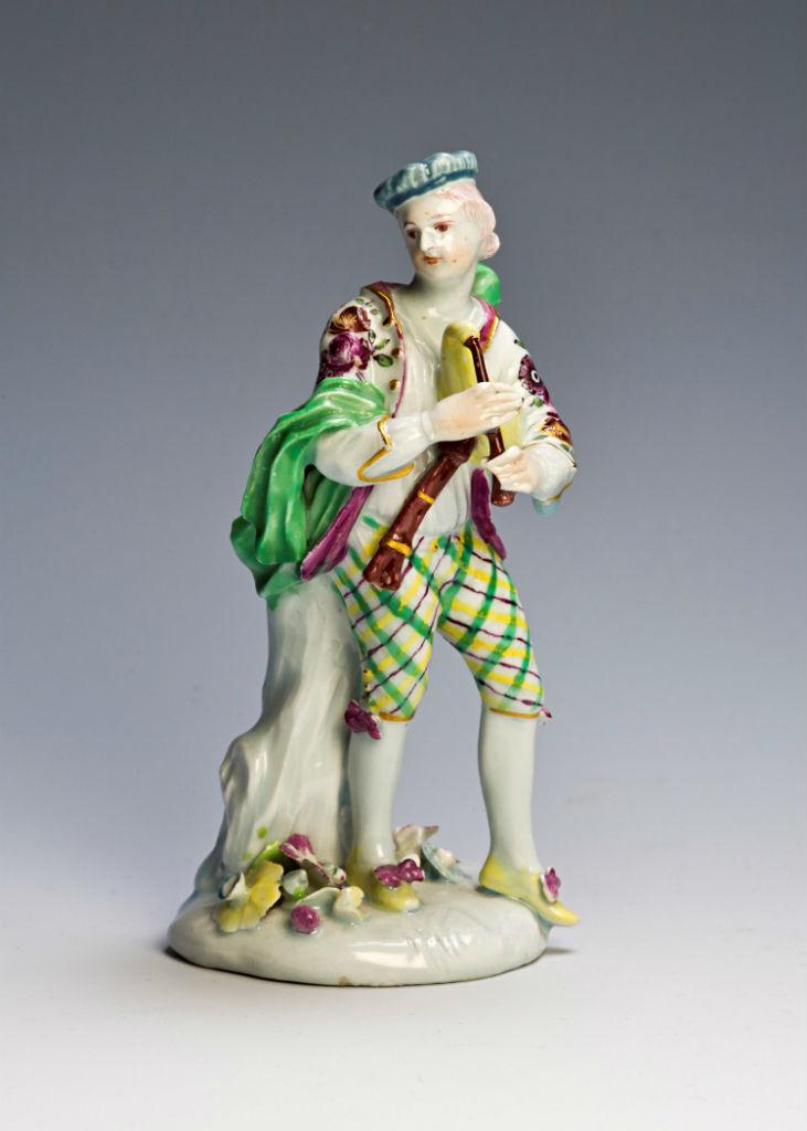 A Derby figure of a bagpiper, circa 1756-60.