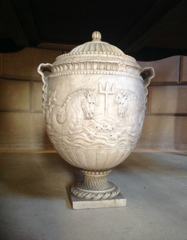 A marble urn and cover, after the Antique.