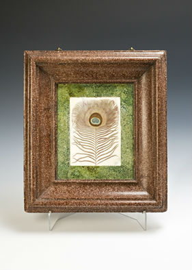 A scagliola frame surrounding a marble panel.