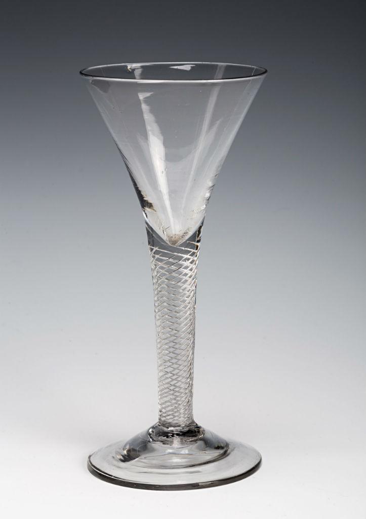 A wine glass, circa 1720.