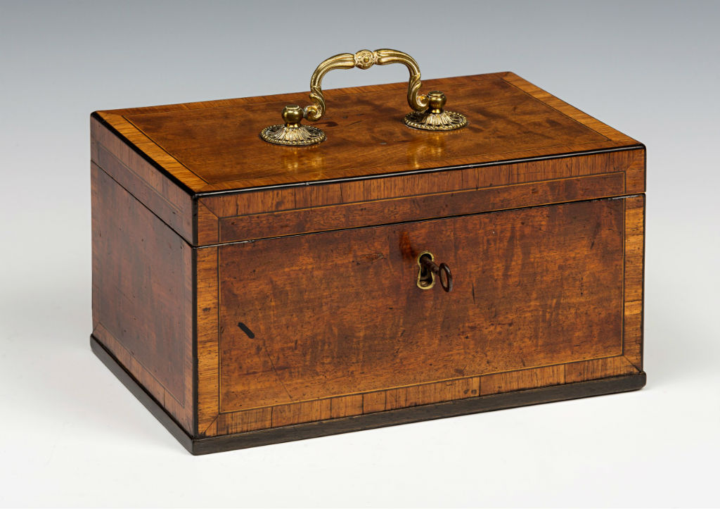 A pair of George III silver-gilt tea-caddies and a sugar-box and cover in a mahogany case.