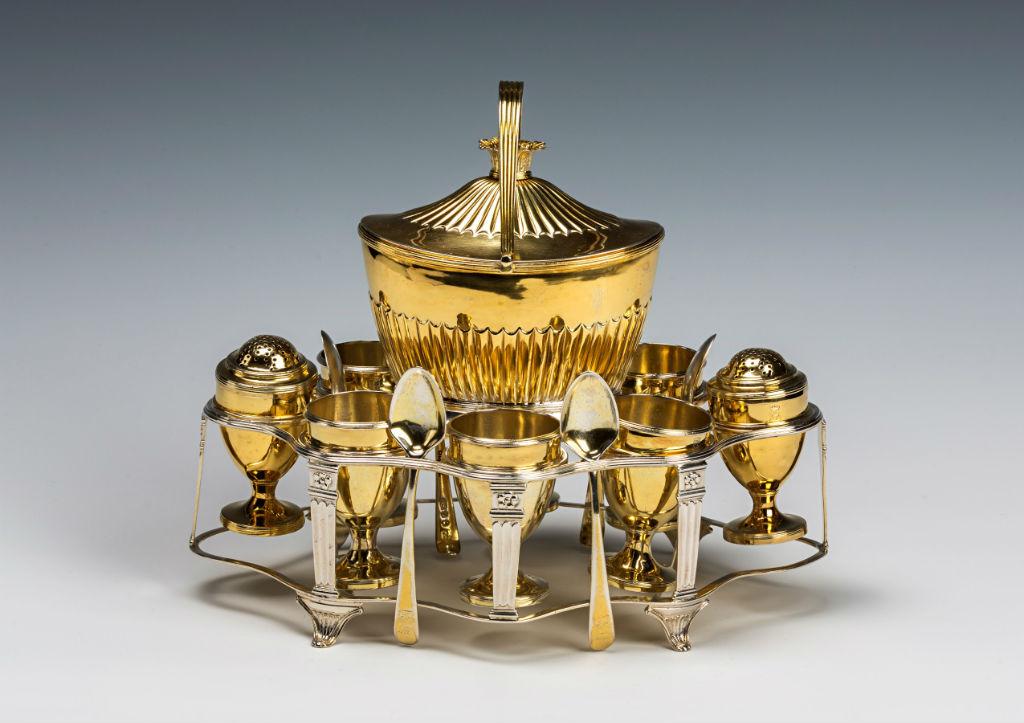 A George III silver-gilt egg-frame.