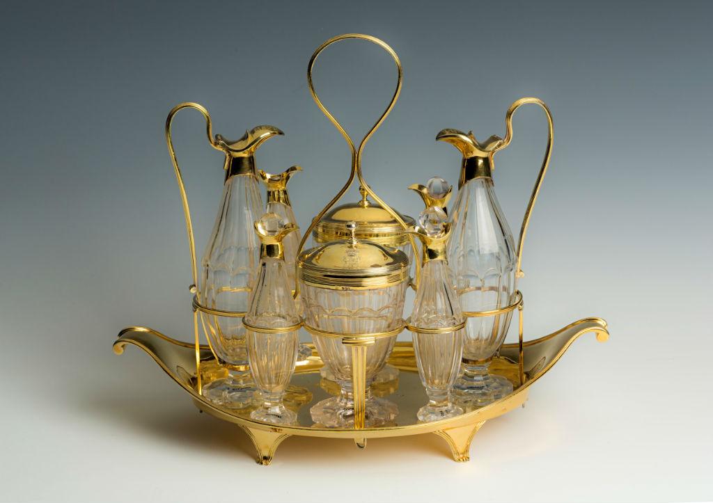 A George III silver-gilt cruet-frame.