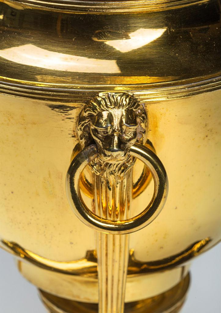 A George III silver-gilt egg-boiler.