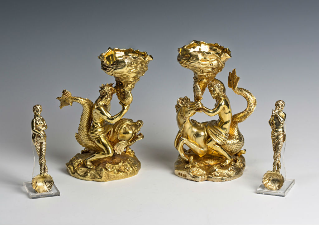 A set of George IV silver-gilt salt-cellars and spoons.