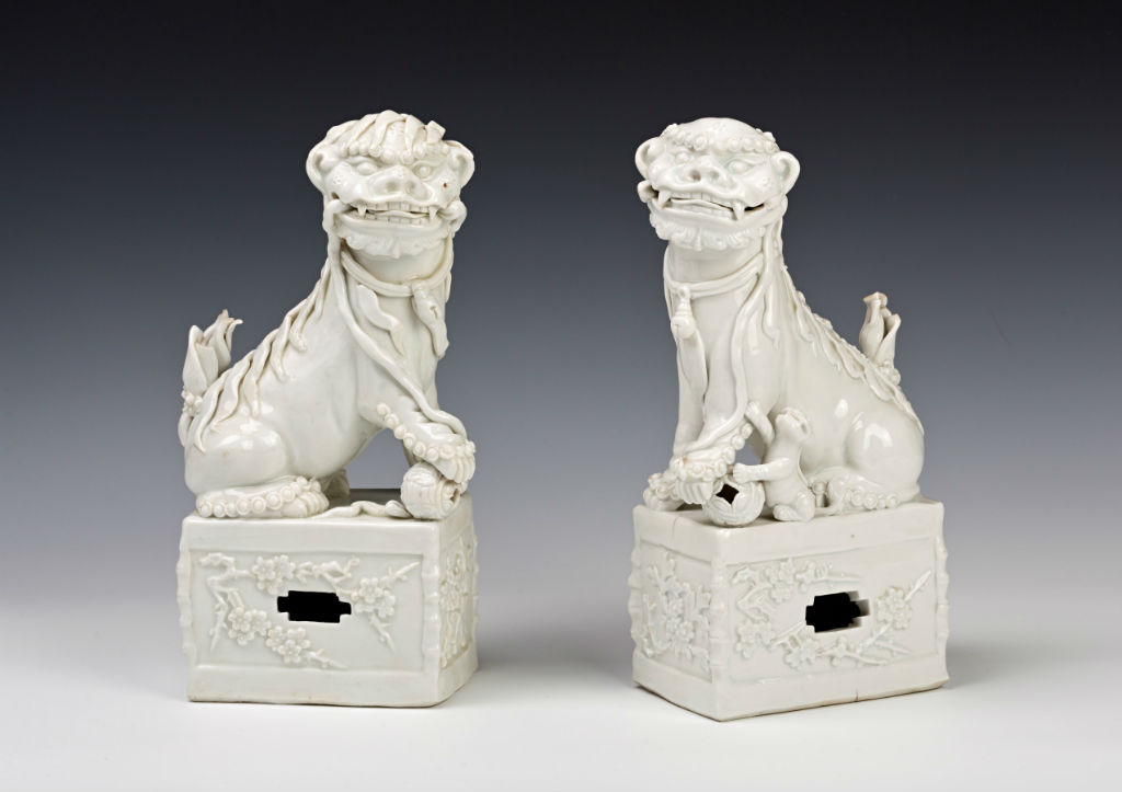 A pair of blanc de chine figures of Buddhist lions, early Kangxi (1662-1722).