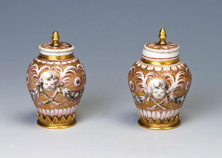 A pair of silver-gilt-mounted European porcellaneous miniature vases and covers, probably circa 1660.