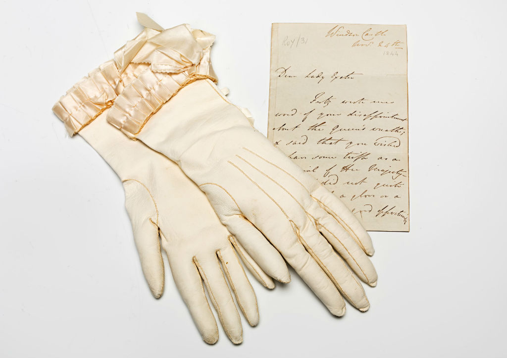 A pair of gloves worn by Queen Victoria at the Christening of Lady Victoria Cecil and a letter from Windsor Castle.