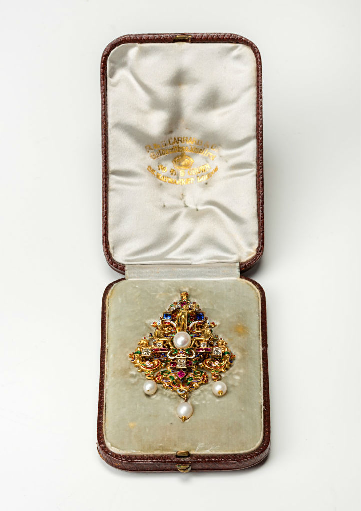 A gold, sapphire, ruby, pearl, diamond and enamel brooch/pendant, circa 1870.