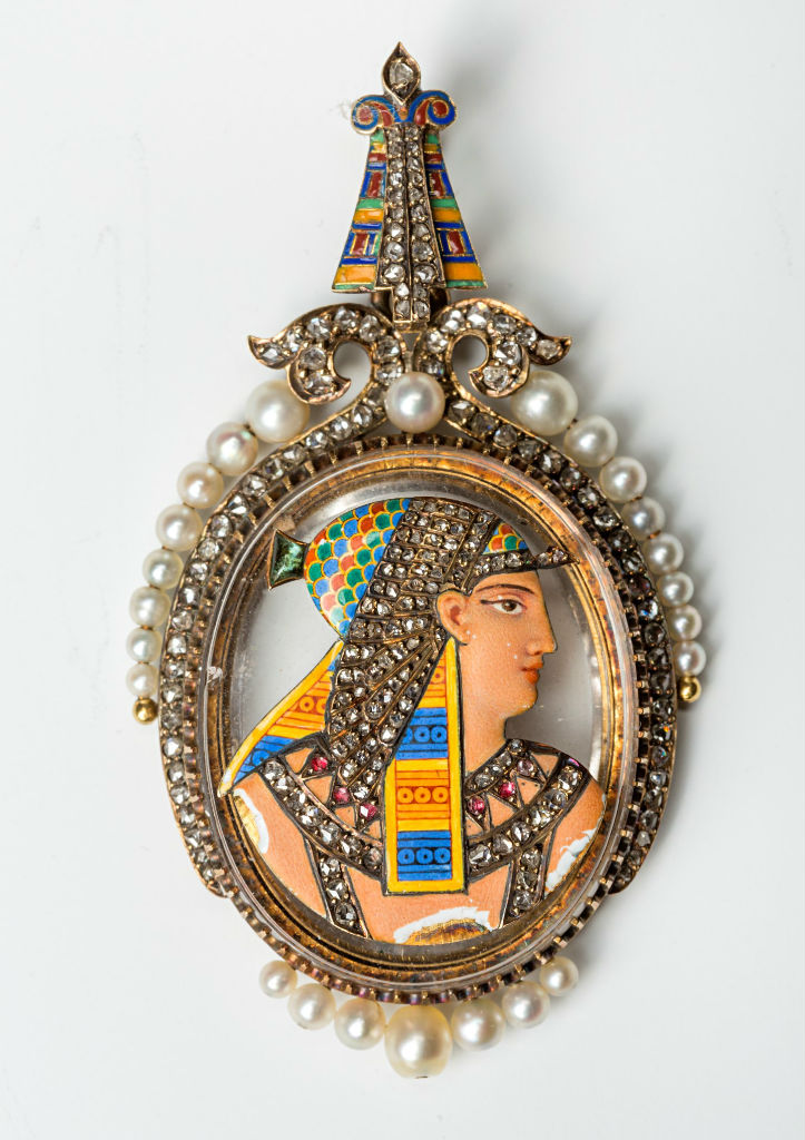 A gold, enamel, pearl and rose diamond locket, French, circa 1880.