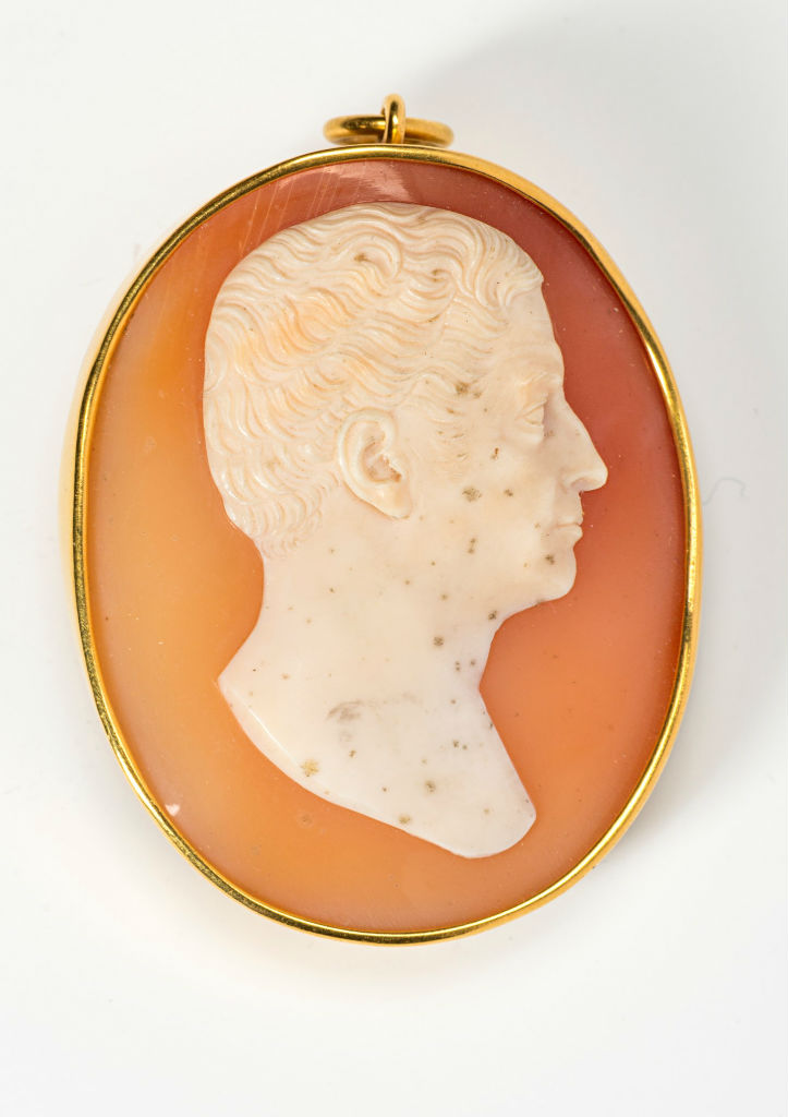 A pair of oval shell cameos, circa 1835.
