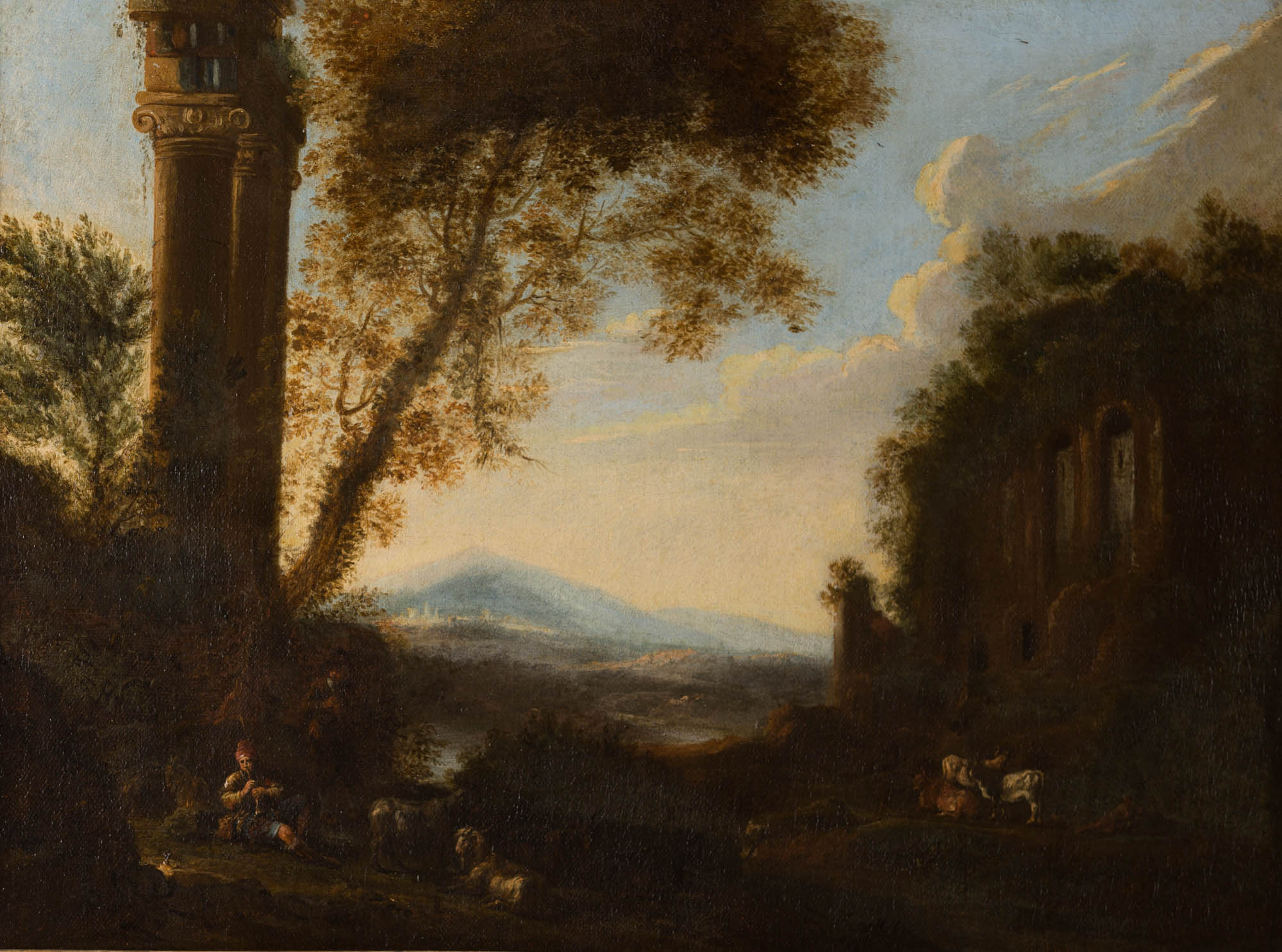 A Shepherd piping to his Goats in an Italianate Landscape, Circle of Frederik De Moucheron (1633-1686).