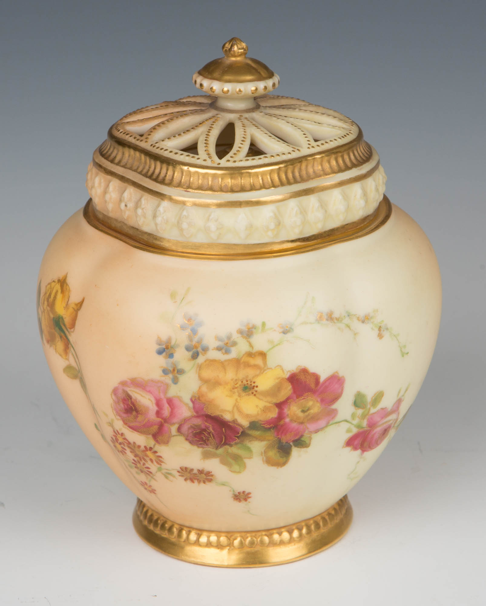 A 19th Century Royal Worcester blush-ivory-ground pot pourri vase, cover and liner.