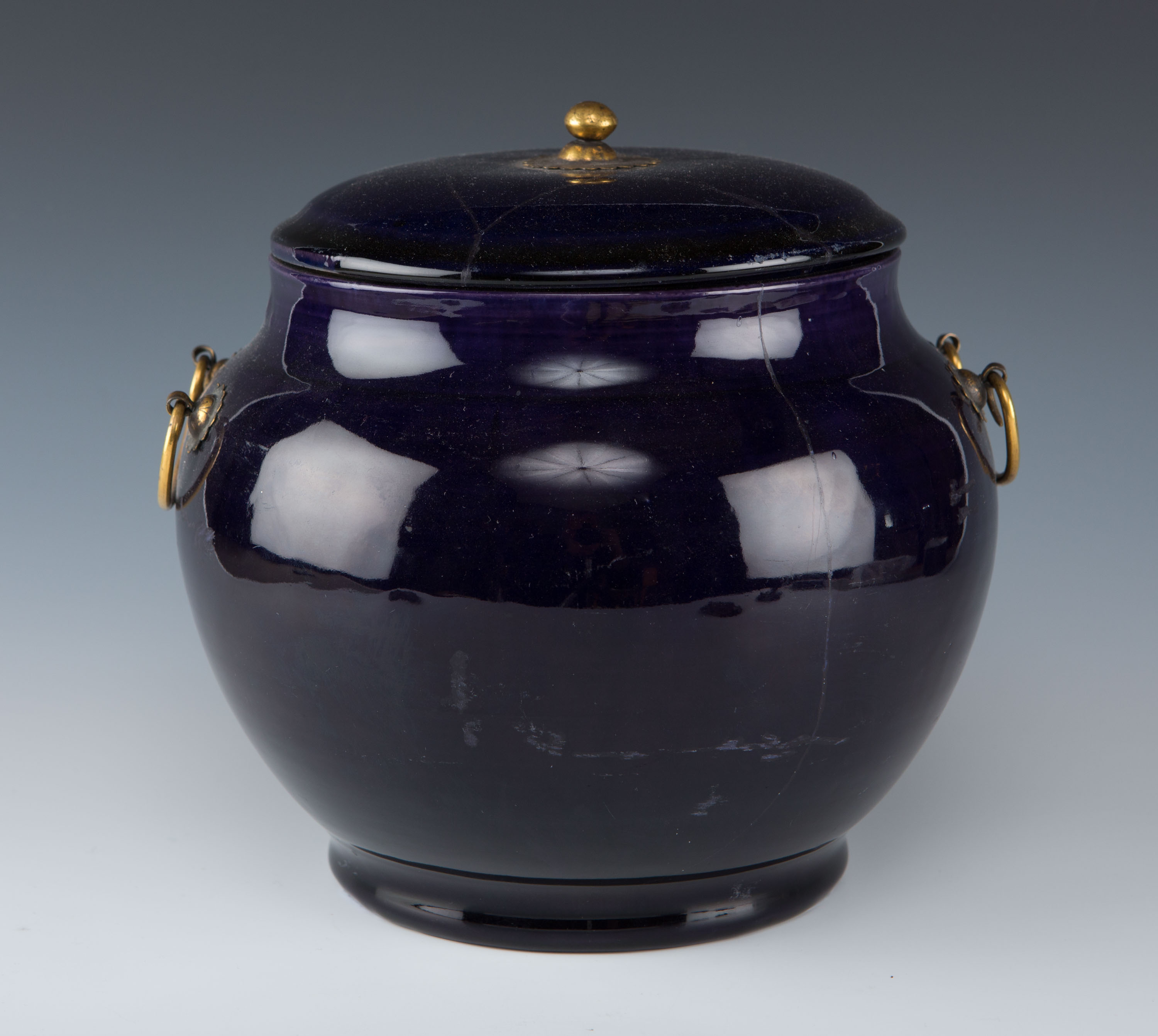 A Chinese Transitional purple-glazed posset pot and cover.