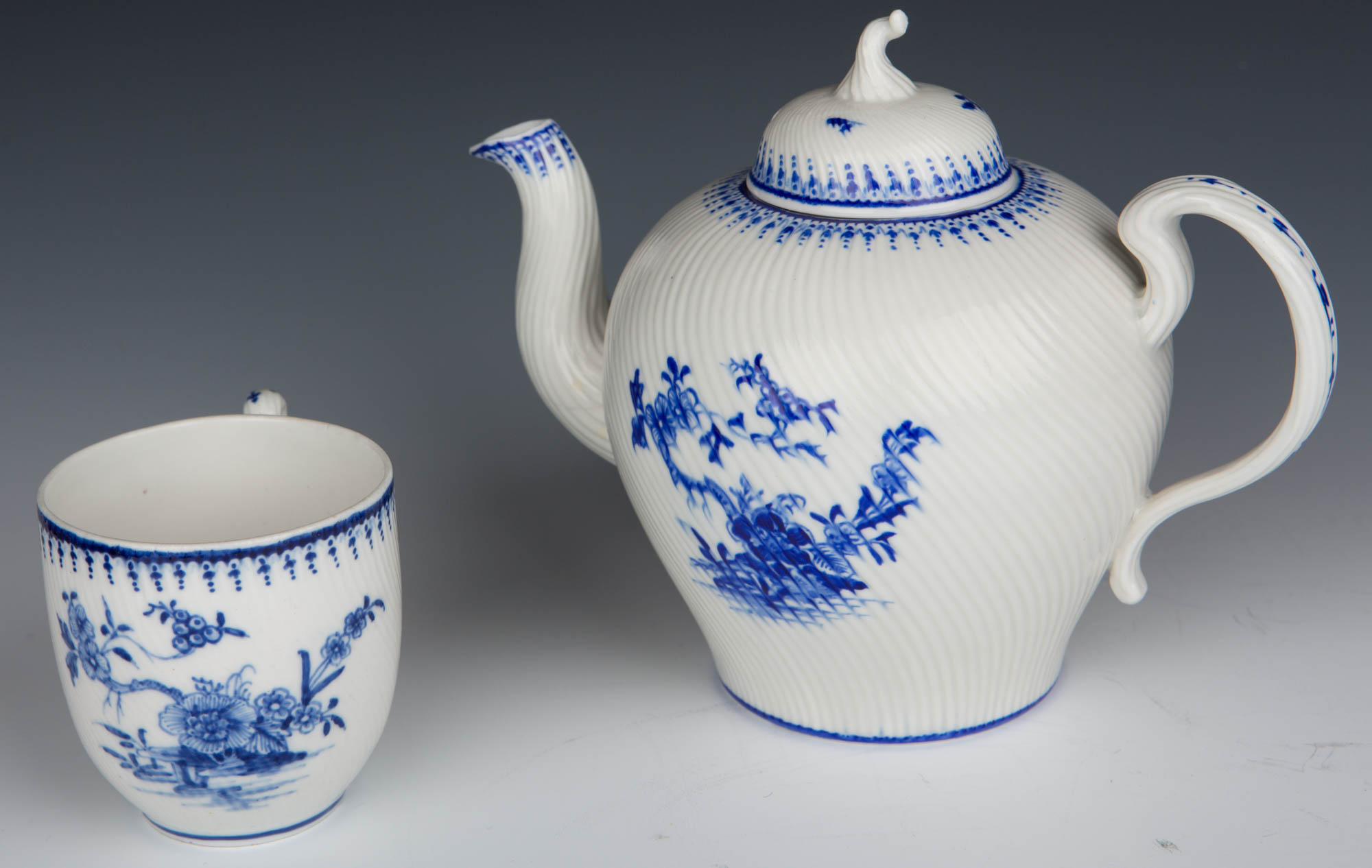 A Tournai coffee cup and bullet-shaped teapot and cover, circa 1760/65.