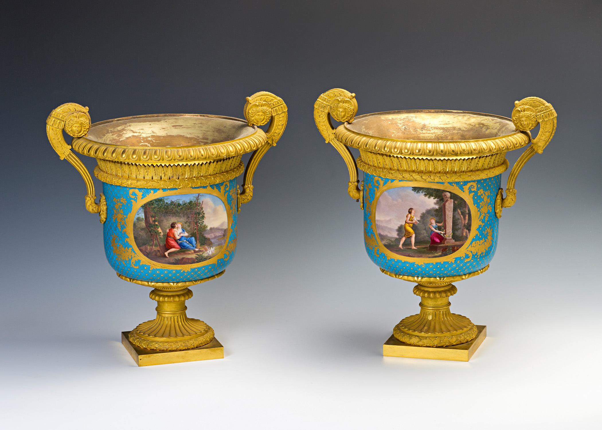 A pair of gilt-bronze-mounted Sèvres-style cachepots, 19th Century.