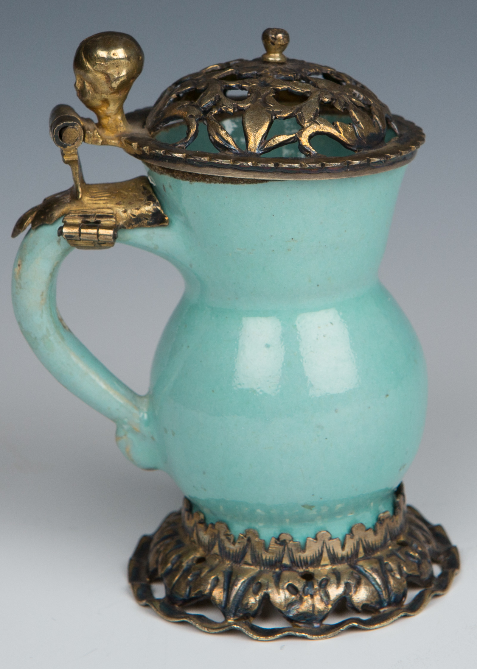 A small silver-gilt-mounted tin-glazed earthenware tankard, circa 1660/80.