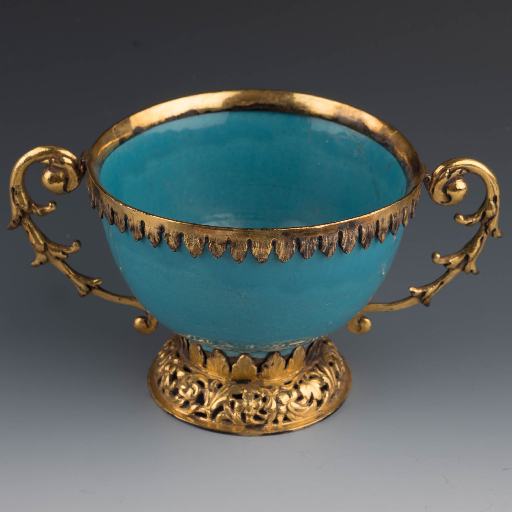 A silver-gilt-mounted turquoise tin-glazed bowl, first half of 17th Century.
