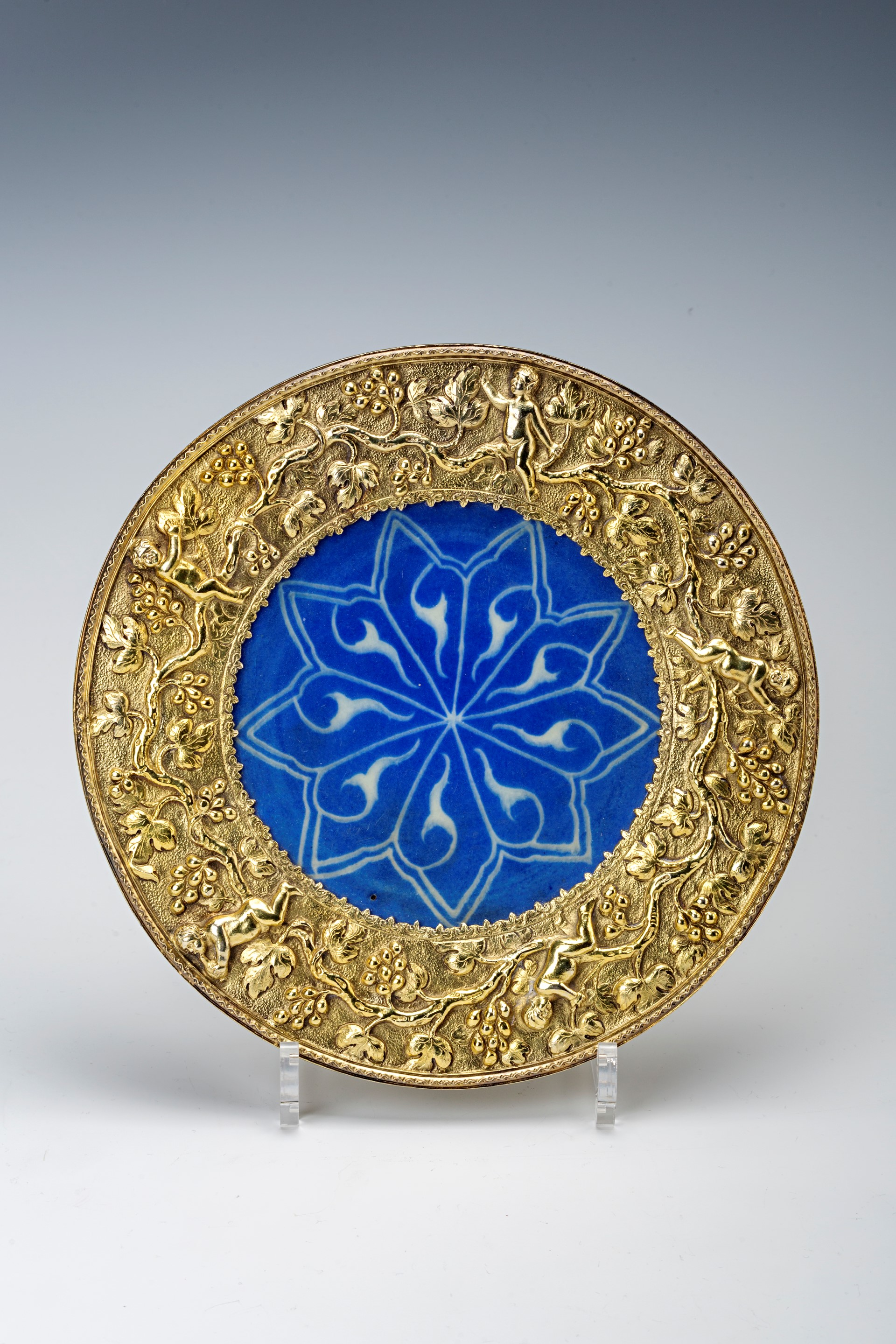 A Persian blue ceramic dish, early 17th Century.