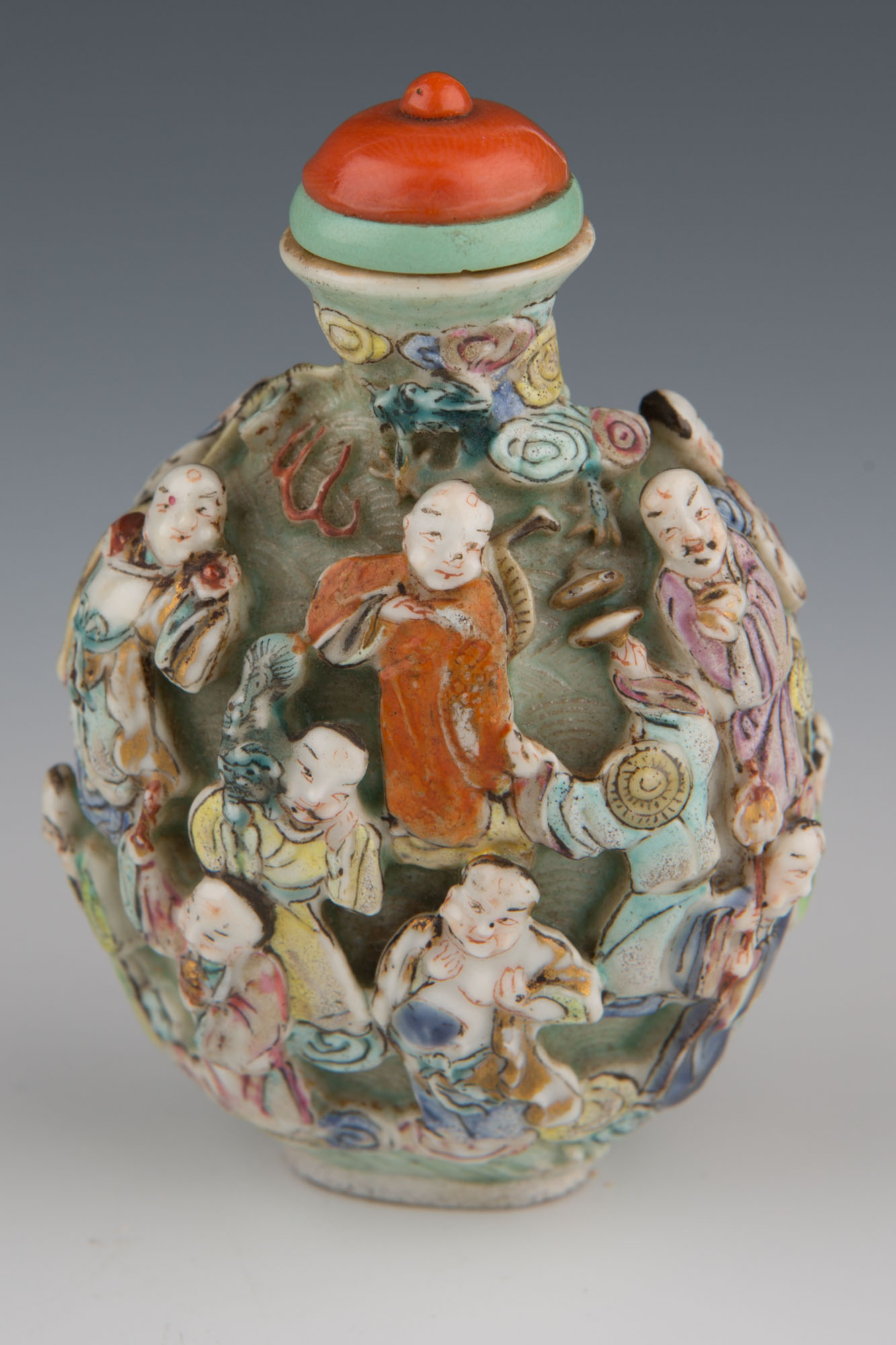 A moulded and enamelled porcelain snuff bottle, 1800-1850.