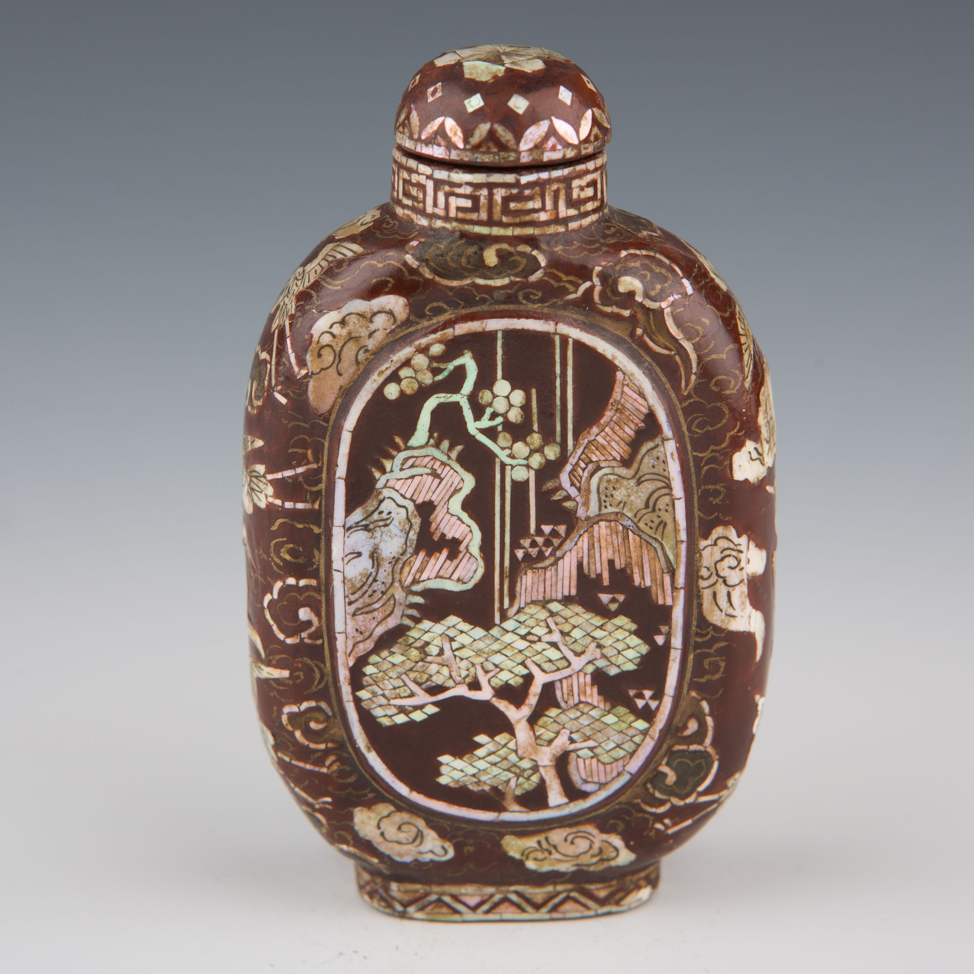 A Chinese, or Korean, lac burgauté snuff bottle, 1800-1920.