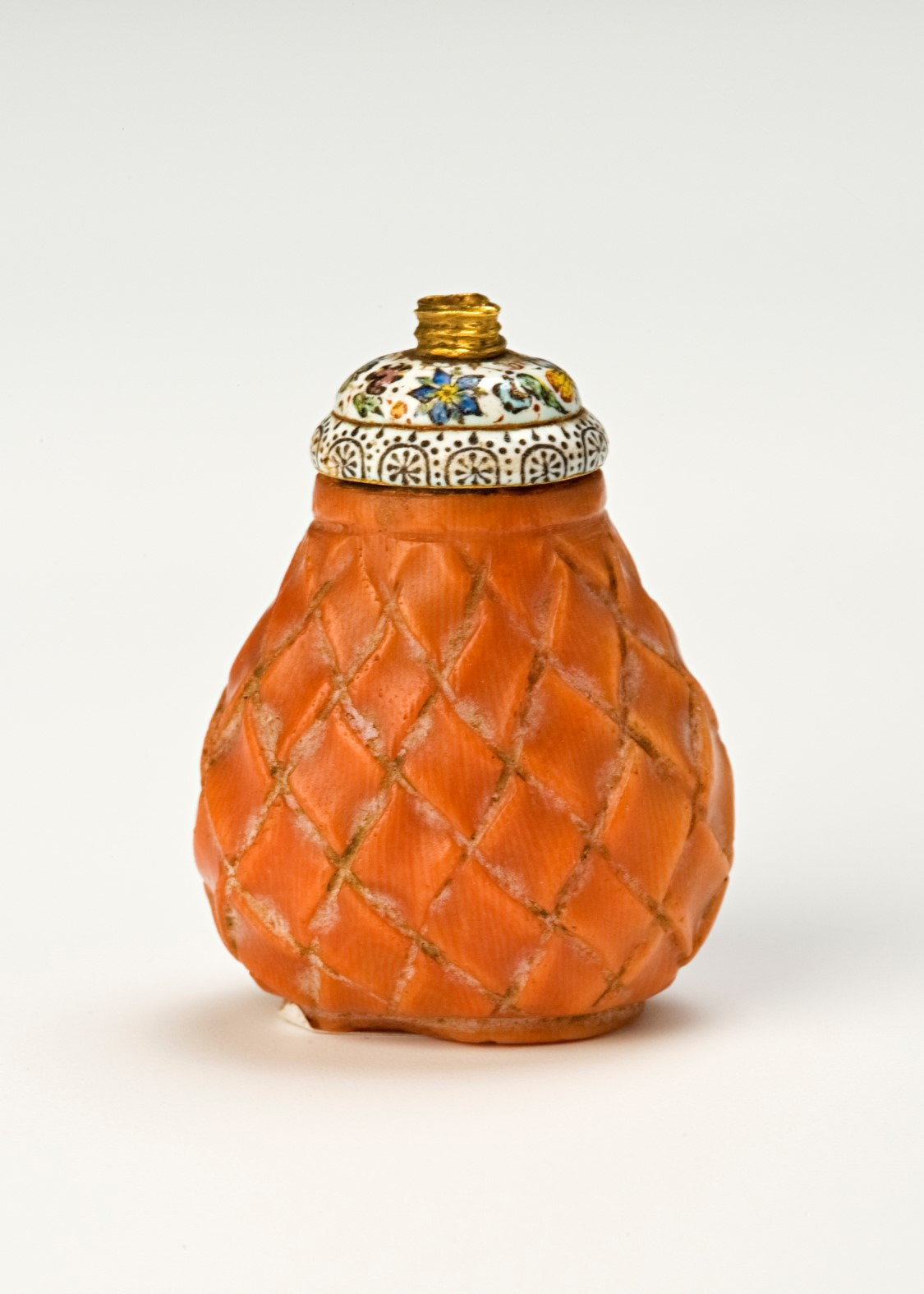 A gold and enamel mounted coral flask, 17th Century.
