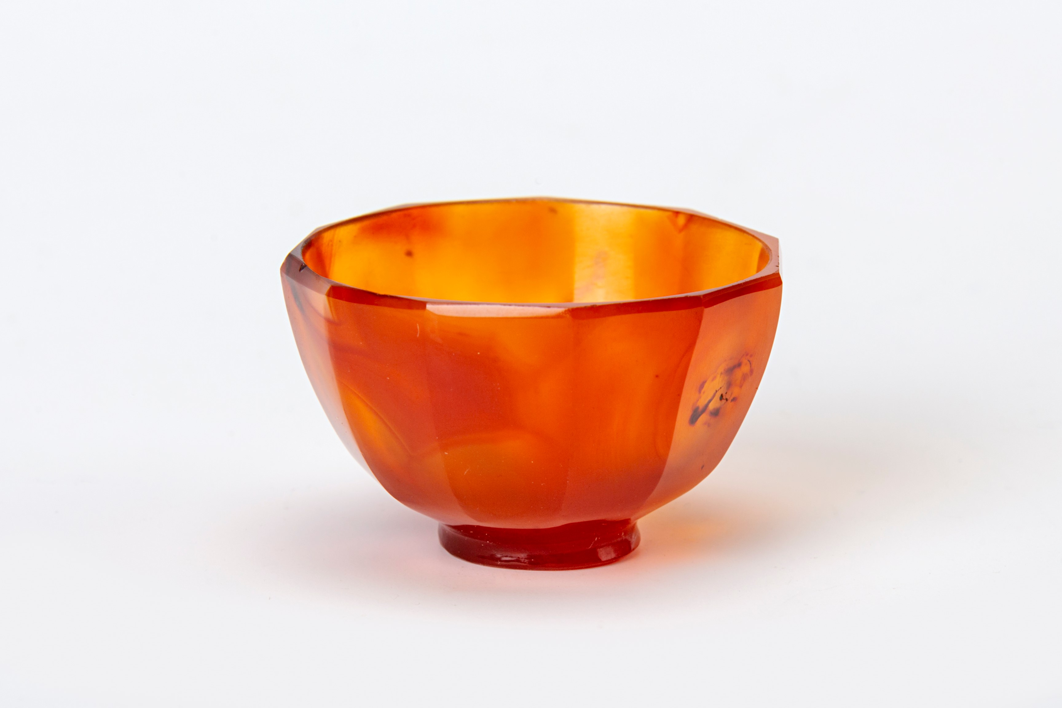 A minature faceted cornelian bowl, 17th Century.