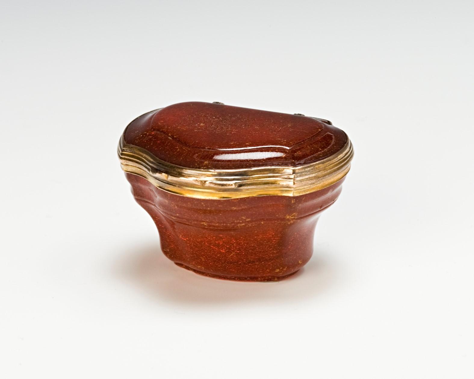 A giltmetal-mounted amber snuff box, mid 18th Century.