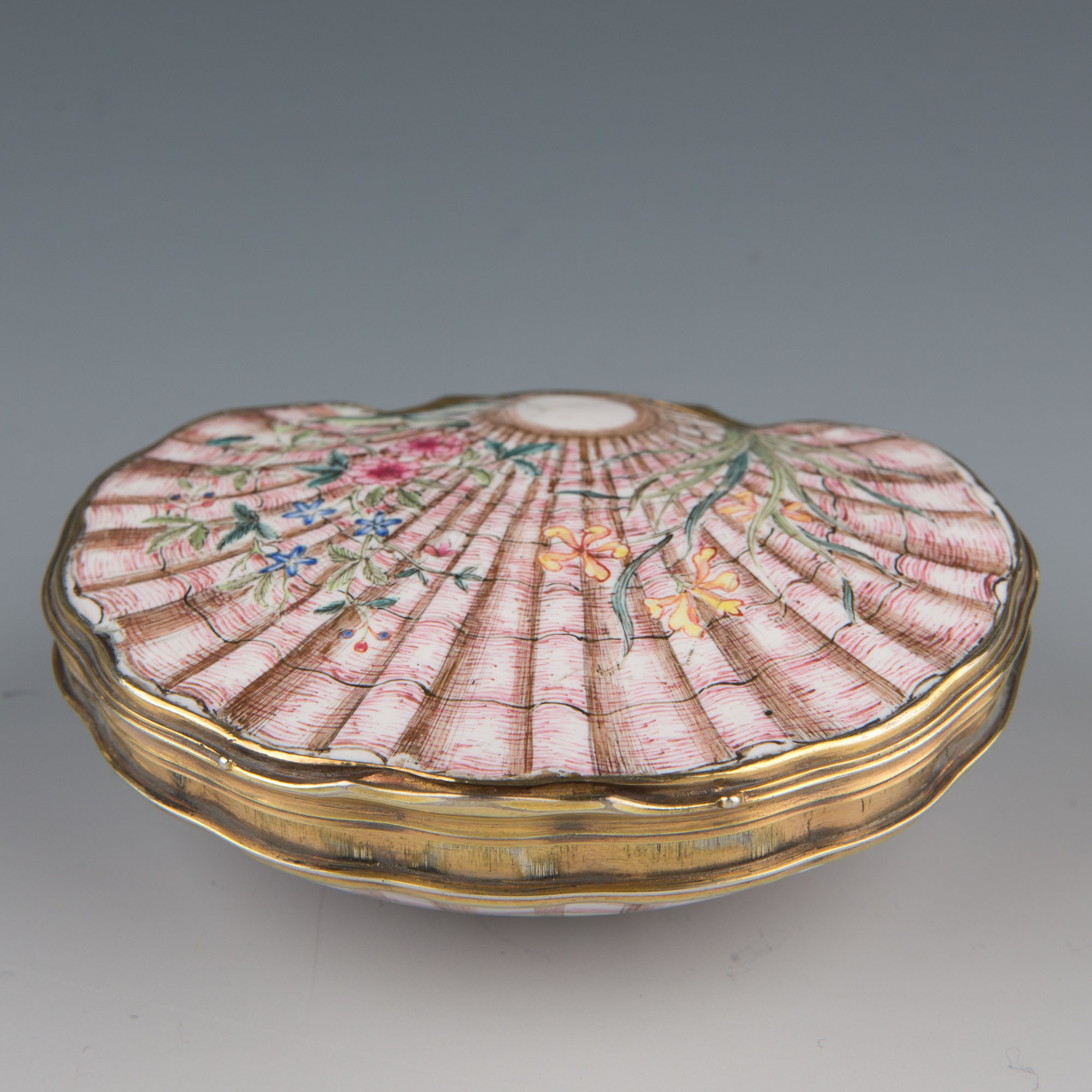 A Cantonese giltmetal-mounted enamel shell snuff box, mid 18th Century.