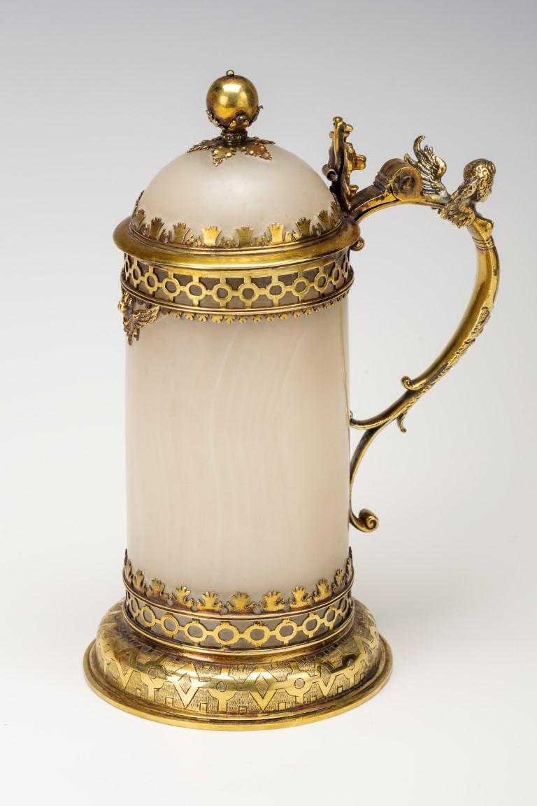 A large silver-gilt mounted hardstone tankard, circa 1610.
